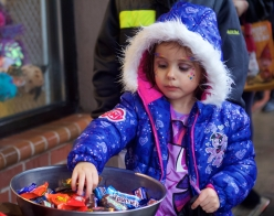 Amira Santoya, a 4-year-old Hillsboro, Oregon resident dressed in a My Little Pony costume, picks out candy while trick-or-treating in downtown Hillsboro. The Safe 'N Sane Halloween event, hosted by the Hillsboro Downtown Partnership, was held on Main Street in Hillsboro on Oct. 31, 2015.